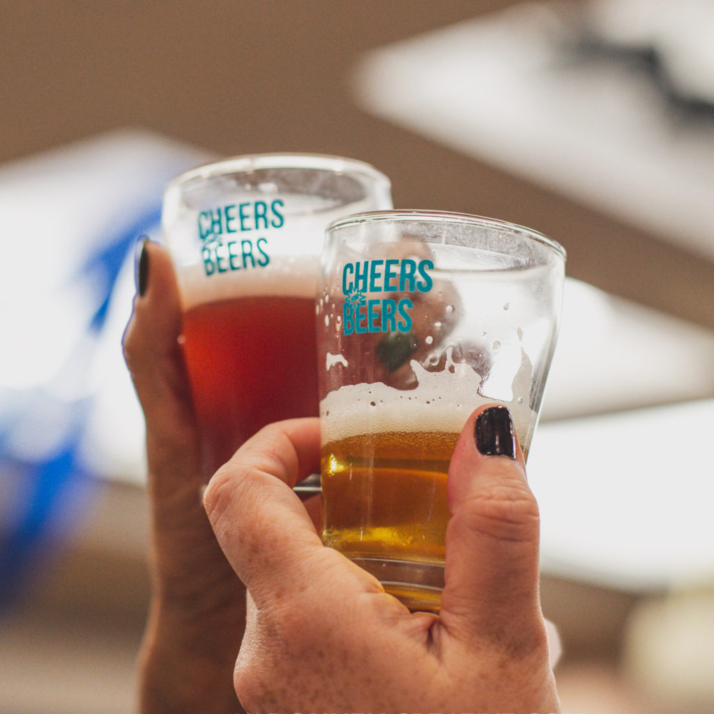 Cheers for Beers sampling glasses raised in a toast