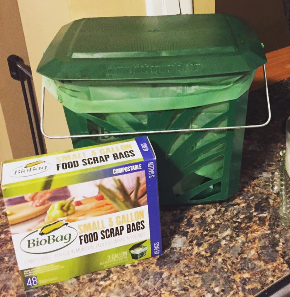 A small kitchen food scraps bin lined with compostable bags is part of the city's curbisde compost pickup program in Columbia Heights, MN.