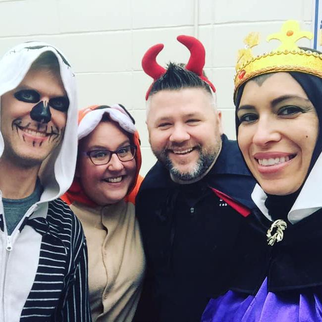 Volunteers in Halloween costumes