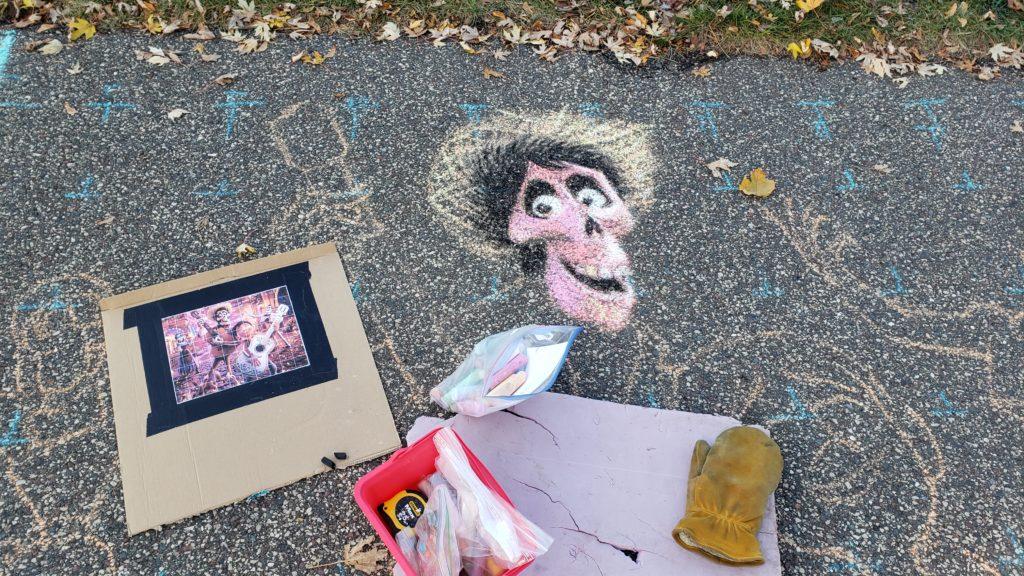 Chalk art beginning to take shape.