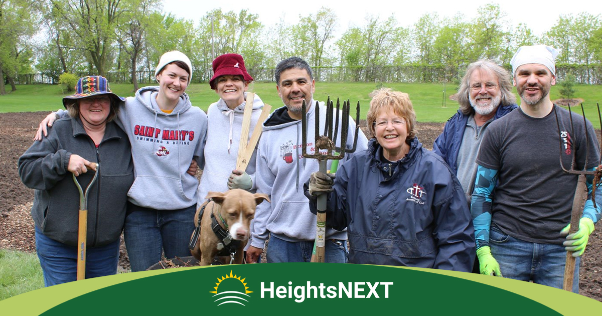 HeightsNEXT gardeners with their tools at Blooming Sunshine food forest in Columbia Heights, MN.