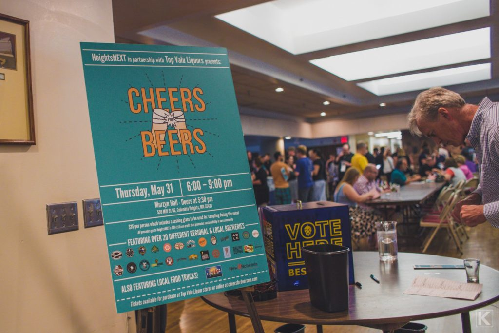 A large sign on an easel reads Cheers for Beers, welcoming patrons to the event.