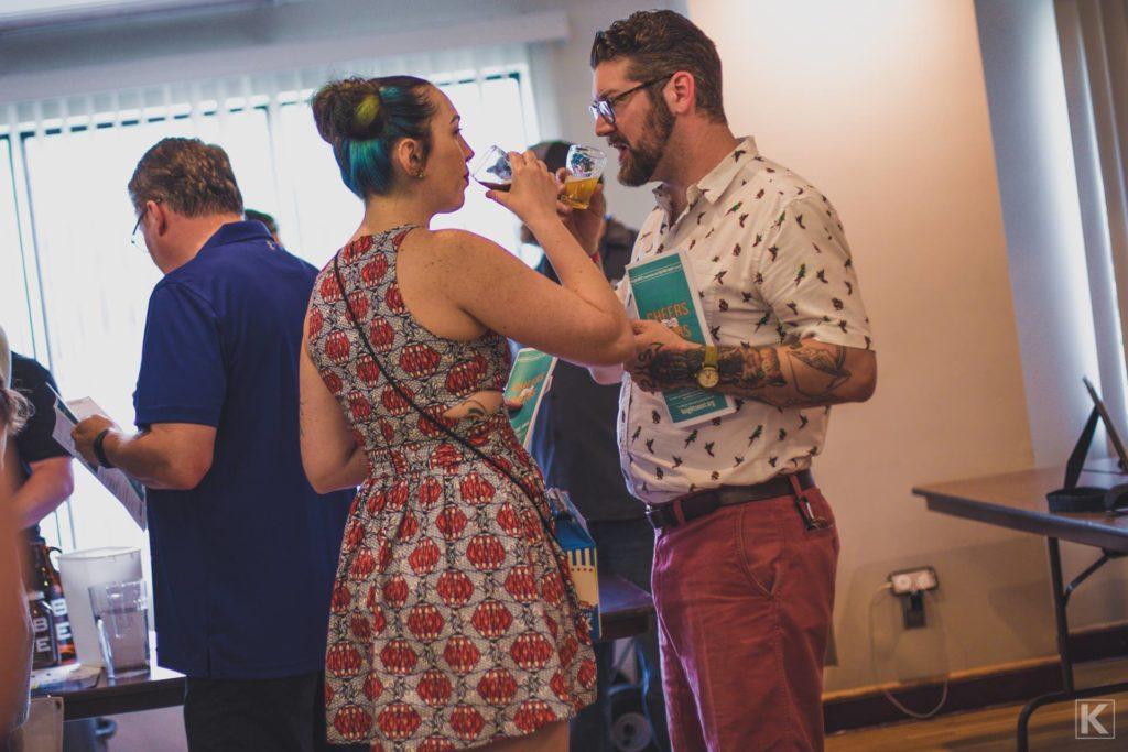 A couple enjoying beer samples