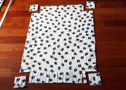 Fleece with 4 inch corners cut out.